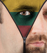Unzipping face to flag of Lithuania