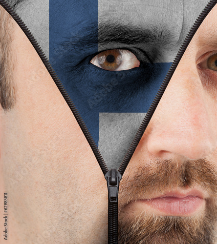 Unzipping face to flag of Finland