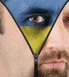 Unzipping face to flag of Ukraine