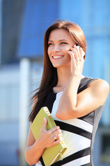 young businesswoman using mobile phone or smartphone