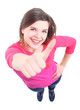 Portrait of attractive young woman showing a thumbs up