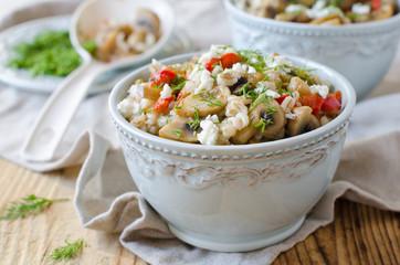 Barley porridge with mushrooms and vegetables