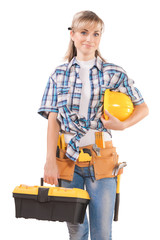 female wearing working clothes with toolbelt holding hardhat and