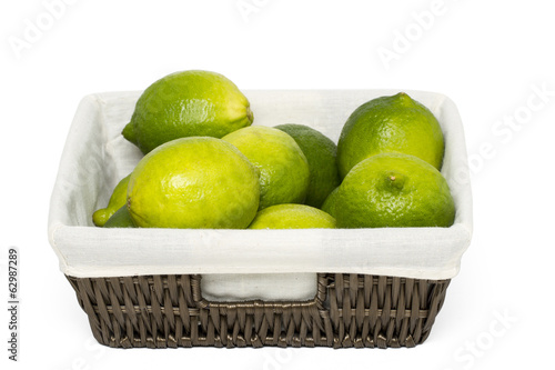 lime fruits inside a wicker basket