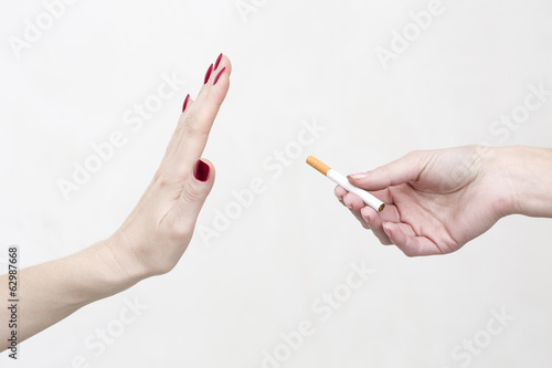 Woman refuses cigarette smoking
