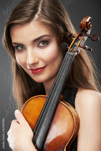 Woman fashion style  portrait with violin music instrument  .