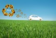 Eco car in the grass, recycle concept with  many sunflowers