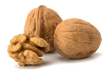 whole and cracked walnut isolated on the white background