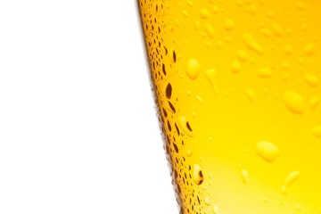 detail of glass of fresh beer with drops on white background
