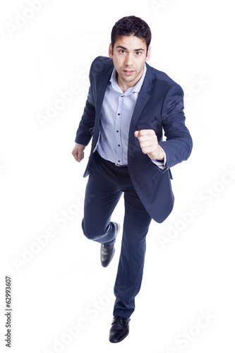 Handsome business man running, isolated on white