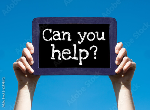 Can you help ? Woman holding blackboard over blue background