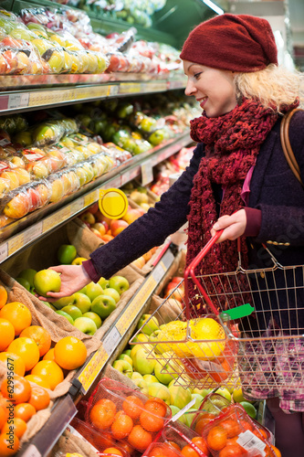 young woman shopping for fruit