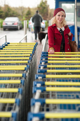 woman using shopping cart at supermarket