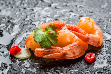 Shrimps served on a wet rock