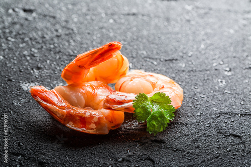 Closeup of shrimps served on a wet rock