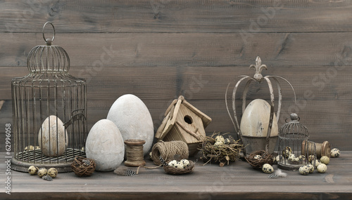 easter decoration with eggs, nest and vintage birdcage