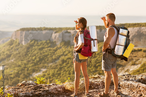 Hikers - people hiking, man looking at mountain nature landscape