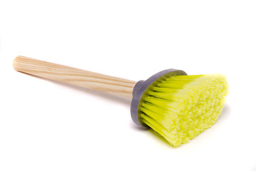 small dust brush with wood handle