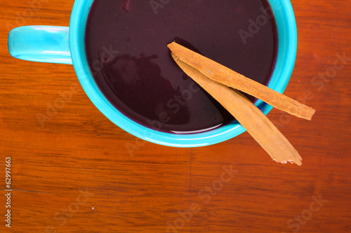 red soup on bowl in a wood background