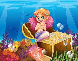 A mermaid under the sea beside the treasures