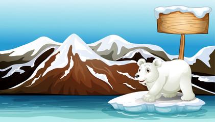 An iceberg in the ocean with an empty signboard and a Polar bear