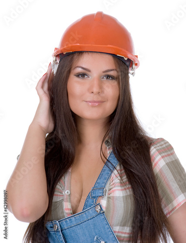 Young woman in jeans and helmet.Isolated.