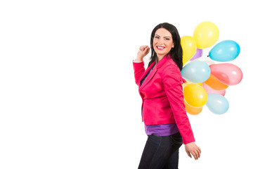 Happy woman walking and holding balloons