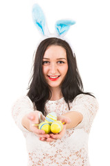 Happy woman give Easter eggs