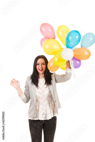 Excited woman with colorful balloons