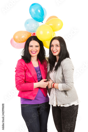 Happy women friends with balloons