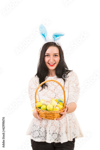 Woman with bunny ears gives Easter basket