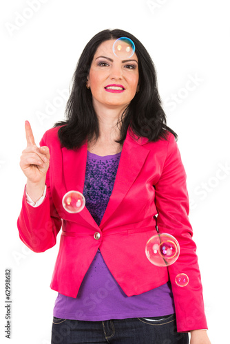 Woman with soap bubbles pointing up