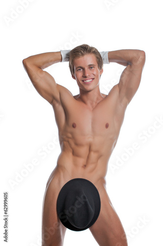 Cheerful naked man posing with hat and gloves
