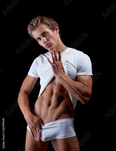 Sexy male underwear model, isolated on black