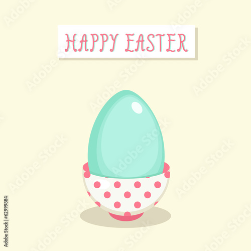 Easter greeting card with bird egg in a mug