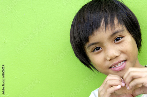 Cute little girl border on green background close-up