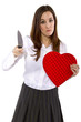 broken hearted ex-girlfriend with a heart and knife