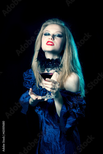 Aggressive vampire woman with glass
