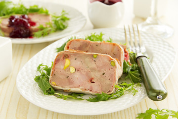 Duck terrine with pistachios and cherries.
