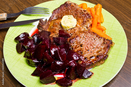 Beef steak with carrots and beetroots