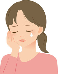 悲しげに涙をこぼす女性
