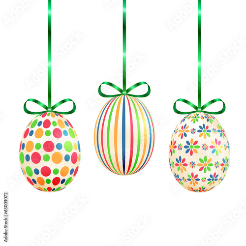 Easter eggs with colorful patterns and ribbons isolated on white