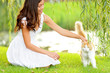 Woman petting cat in summer park