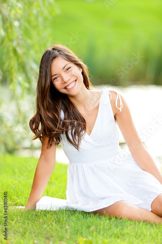 Brunette woman in summer park