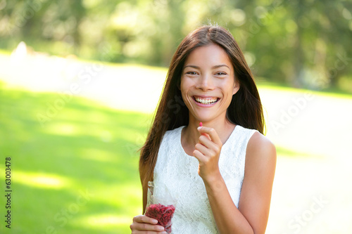 Woman eating goji berries