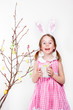 Decorating magnolia branch with Easter eggs