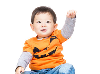Asian baby boy with halloween dressing and hands up