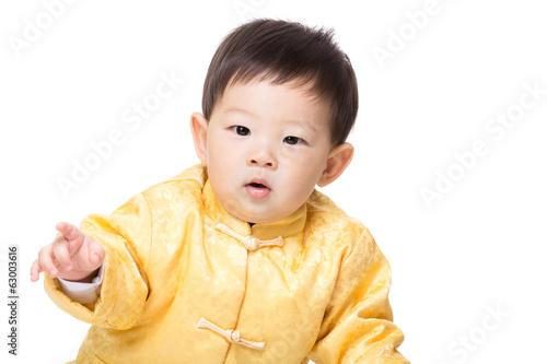 Asia baby boy with golden chinese costume
