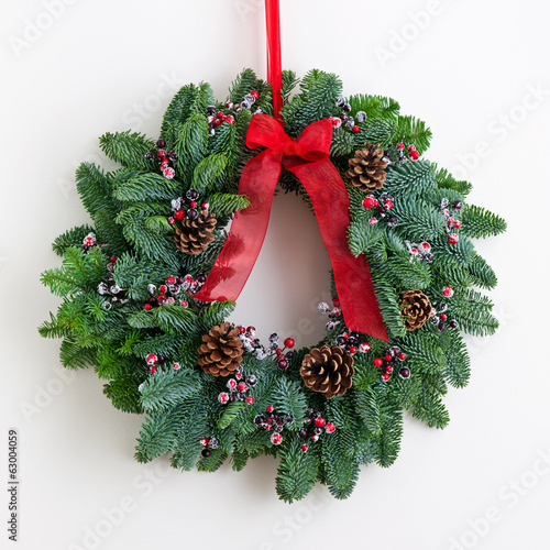 Advent wreath with red ribbon
