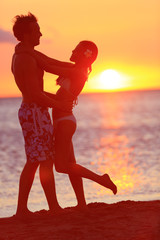 Romantic couple kissing on beach sunset on travel